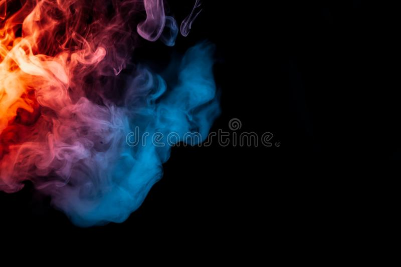 Abstract texture of blue, orange and violet smoke igniting on a royalty free stock photography