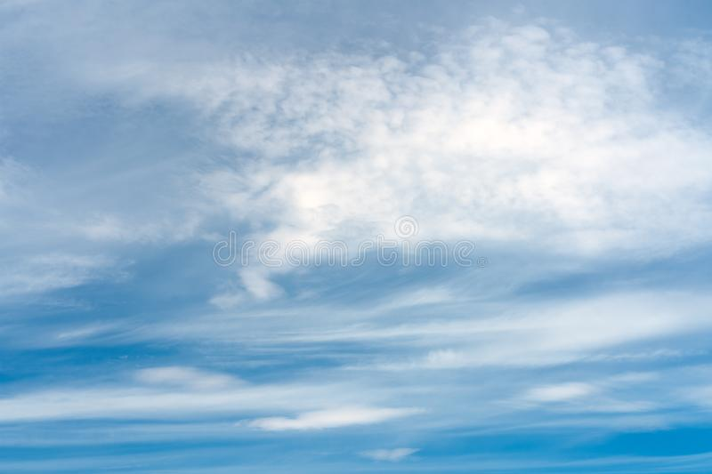 Abstract texture of blue sky with feather and soft clouds royalty free stock photos