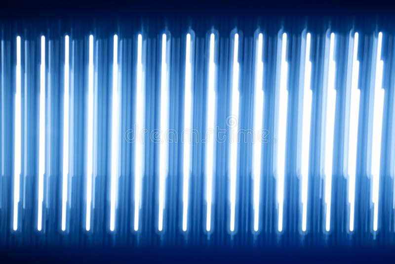 Abstract texture luminous light strips. blue glow. a lot of light rays halogen diodes bright substrate dark wallpaper stock image