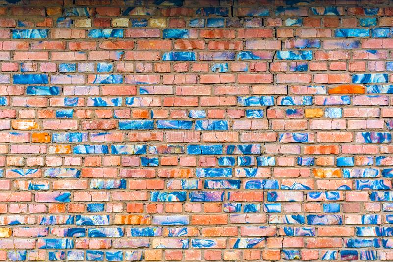 Abstract texture of old cracked red-blue brick wall.  stock photo