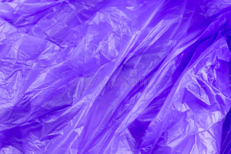 Abstract texture of purple cellophane garbage bag. macro close-up background stock image