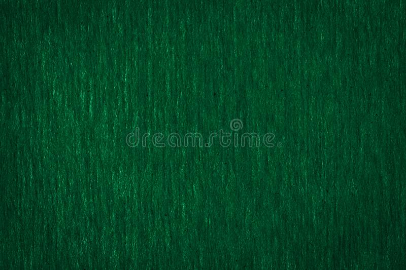 Abstract texture of a rough dark green paper background and copy space for text. royalty free stock photos
