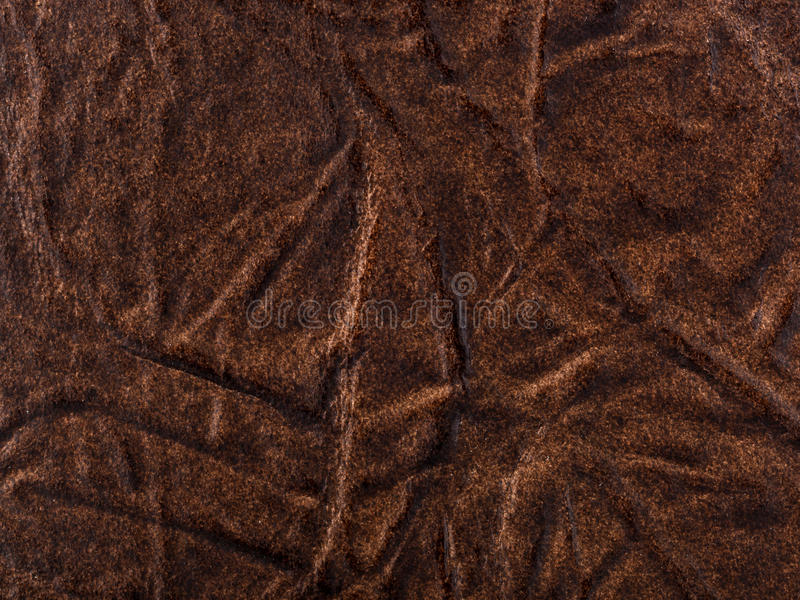 Abstract texture of synthetic leather. Brown background stock image