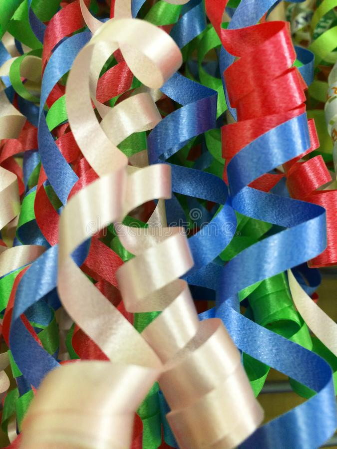 Colorful party decorations. Abstract textured background created by spirals of paper decorations (ribbons) in various colors for use at a party royalty free stock photos