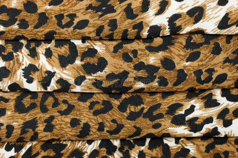 Abstract textured background of folded animal print fabric royalty free stock image