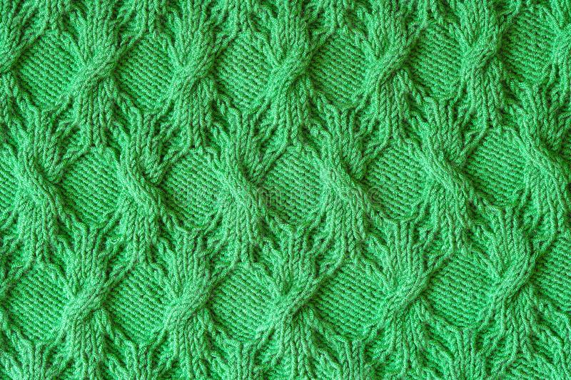 Abstract textured background of green knitting royalty free stock image