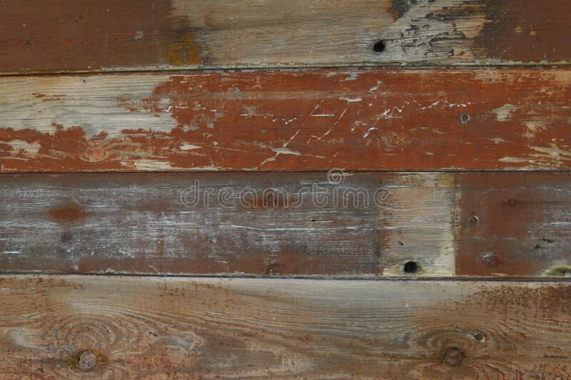 Abstract textured background. Old brown wooden painted surface from cracked boards. The texture of a wooden board. Close-up, free space, horizontal royalty free stock image