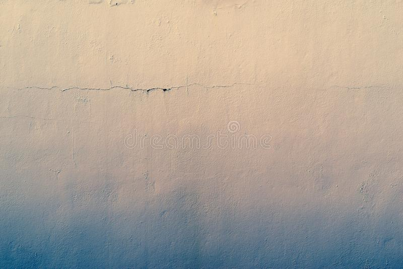 Abstract textured background of the old plastered surface. The abstract textured background of an old surface of the plastered wall of a motley color tonality royalty free stock images