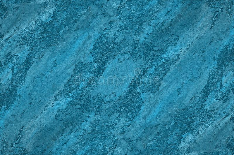 Abstract textured decorative stucco background in blue colors. stock photography