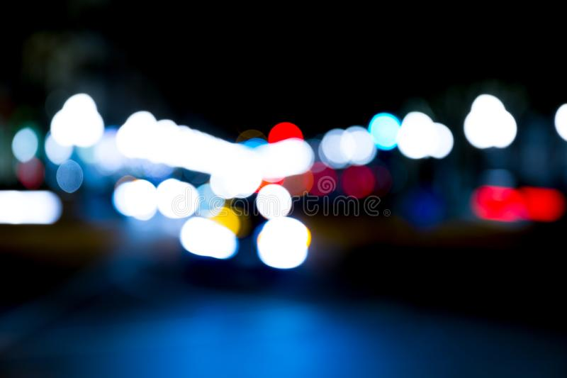 Abstract traffic lights on urban street at night. Abstract bokeh, blurred motion royalty free stock images