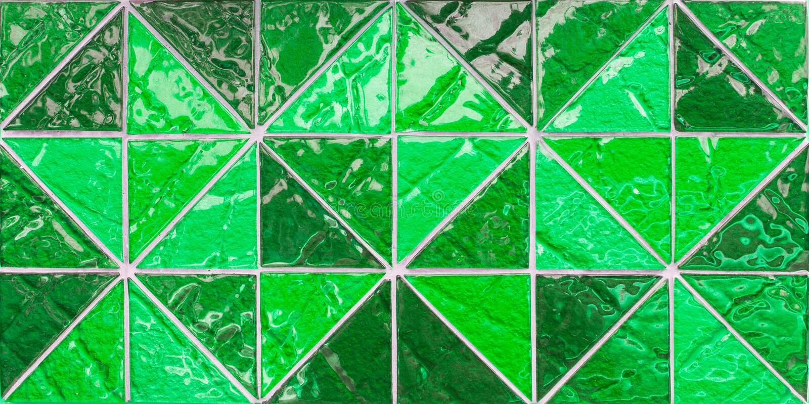 Abstract triangle pixel mosaic wall background and texture. Abstract green triangle pixel mosaic wall background and texture stock photo