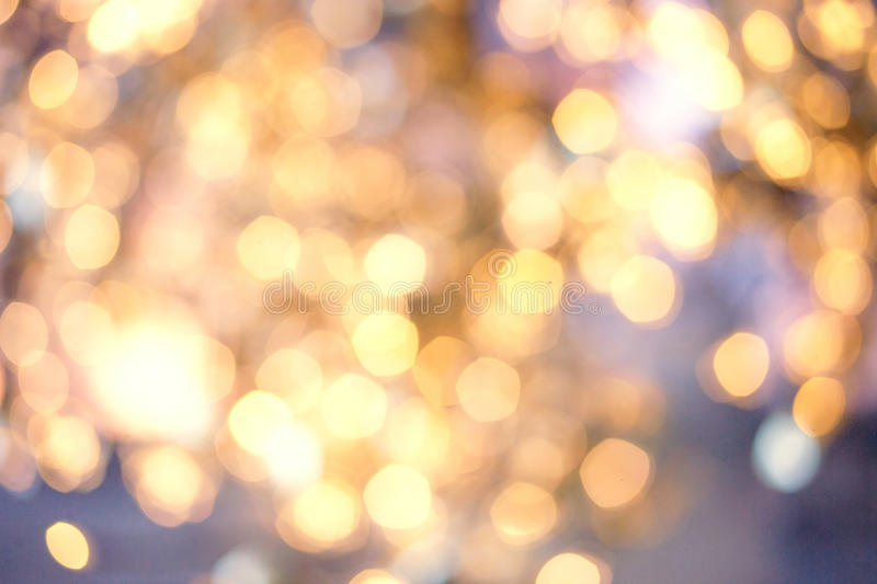 Abstract twinkled Christmas lights background with bokeh. Golden stock photos