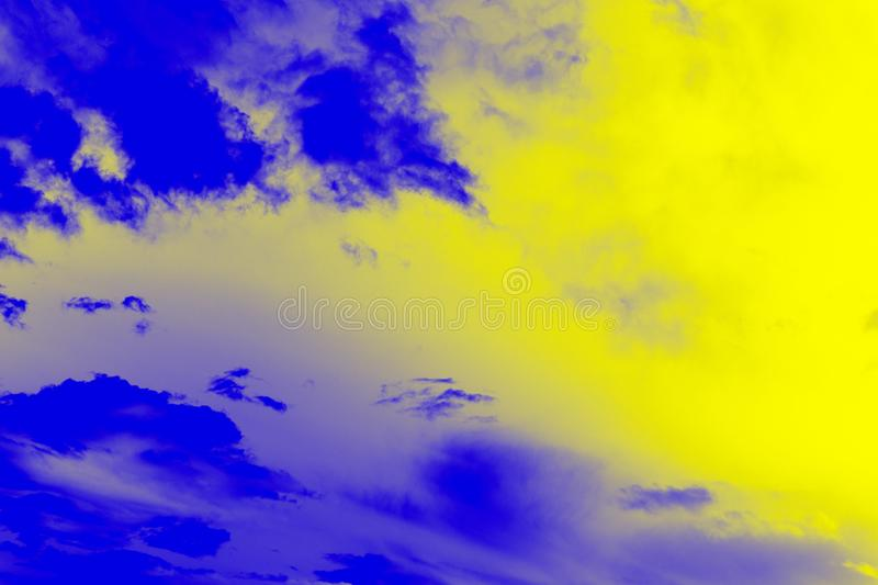 Abstract ultra modern sky background. Yellow lemon color and ultramarine blue colors stock photography