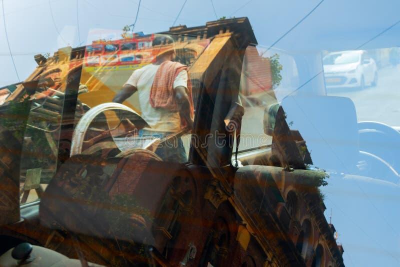 Abstract urban image of street of Kolkata. Abstract urban image of steet of Kolkata - Reflection of a rickshaw puller pulling a rikshaw, an old house of Kolkata royalty free stock photo