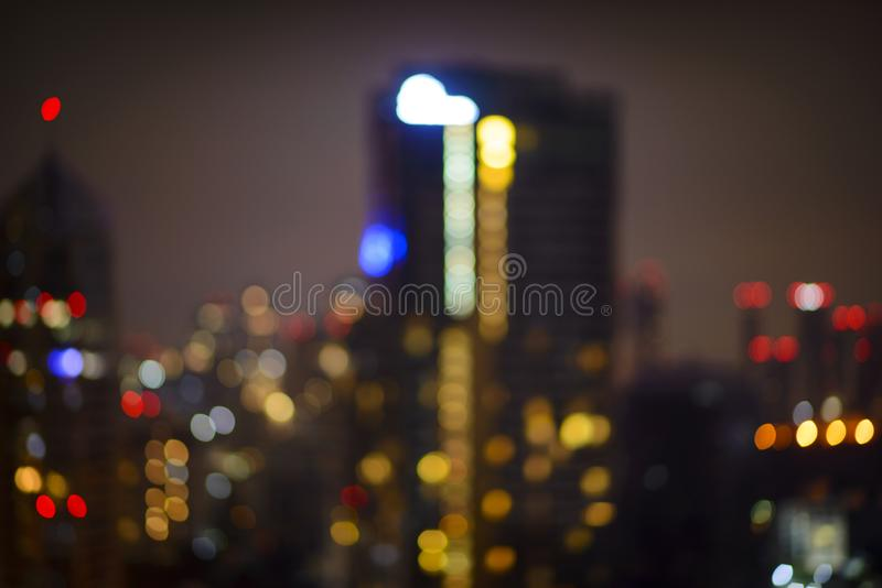 Abstract urban night light bokeh defocused background royalty free stock image