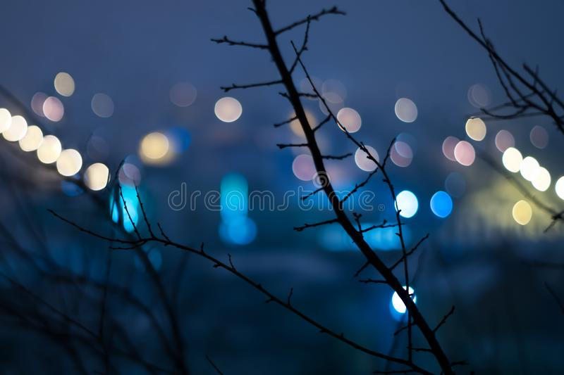 Abstract urban night light bokeh, defocused background. royalty free stock image