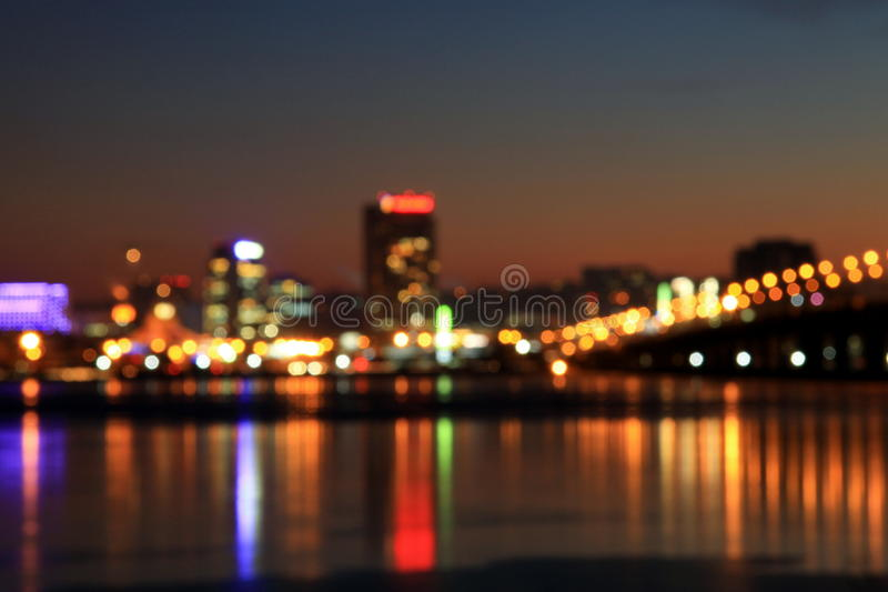 Abstract urban night light bokeh, defocused background stock photography