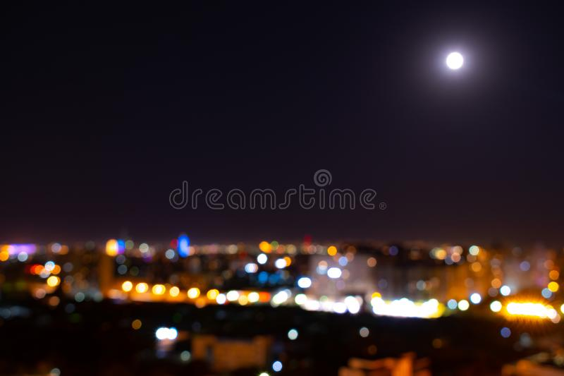 Abstract urban night light bokeh defocused background. Moon night royalty free stock photography