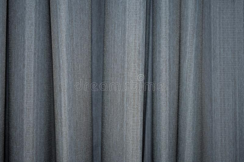 Abstract vertical hanging curtain fabric texture. Abstract vertical hanging curtains drapes textured background royalty free stock photo