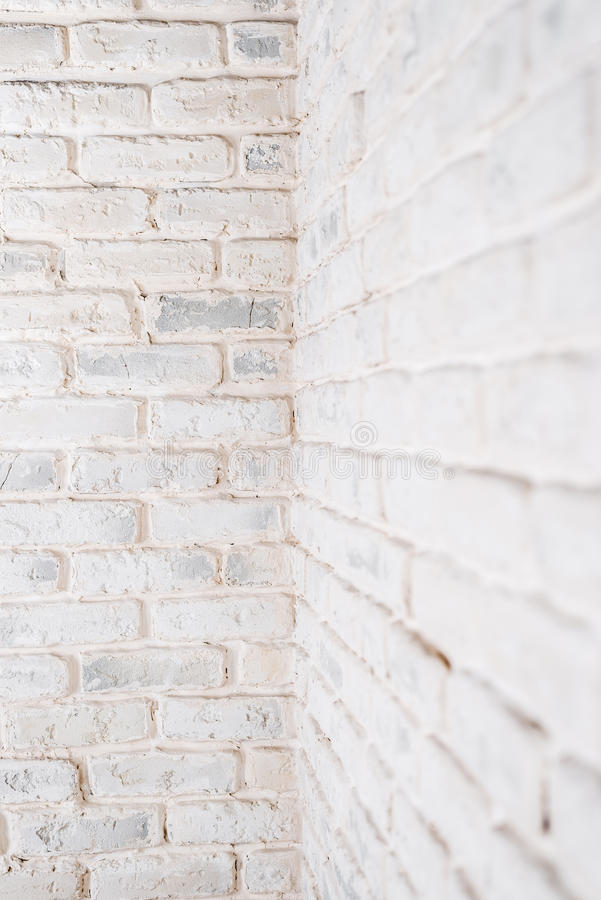 Abstract vertical white background. The corner of the brick wall. Abstract vertical white background. The corner of the brick shabby wall royalty free stock photography