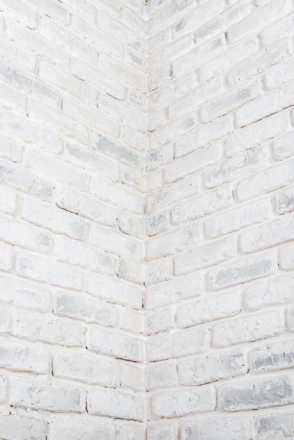 Abstract vertical white background. The corner of the brick wall. Abstract vertical white background. The corner of the brick shabby wall stock images
