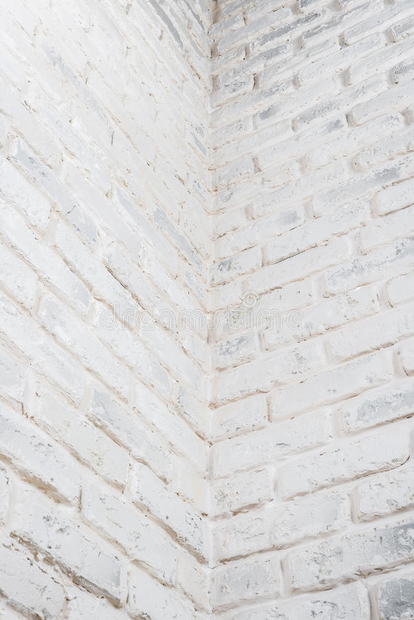 Abstract vertical white background. The corner of the brick wall. Abstract vertical white background. The corner of the brick shabby wall stock image