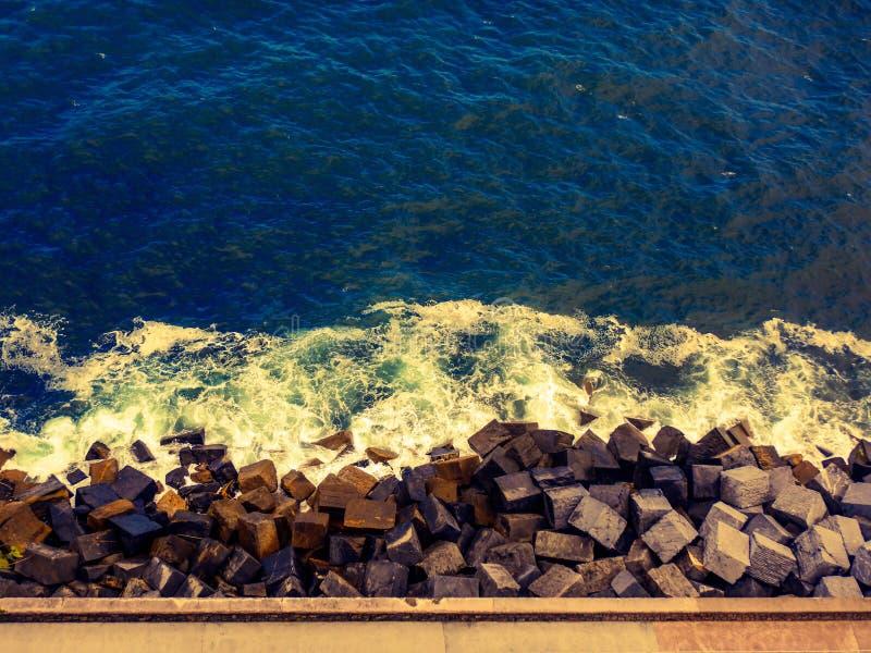 Vibrant ocean and rocks shoreline royalty free stock photos