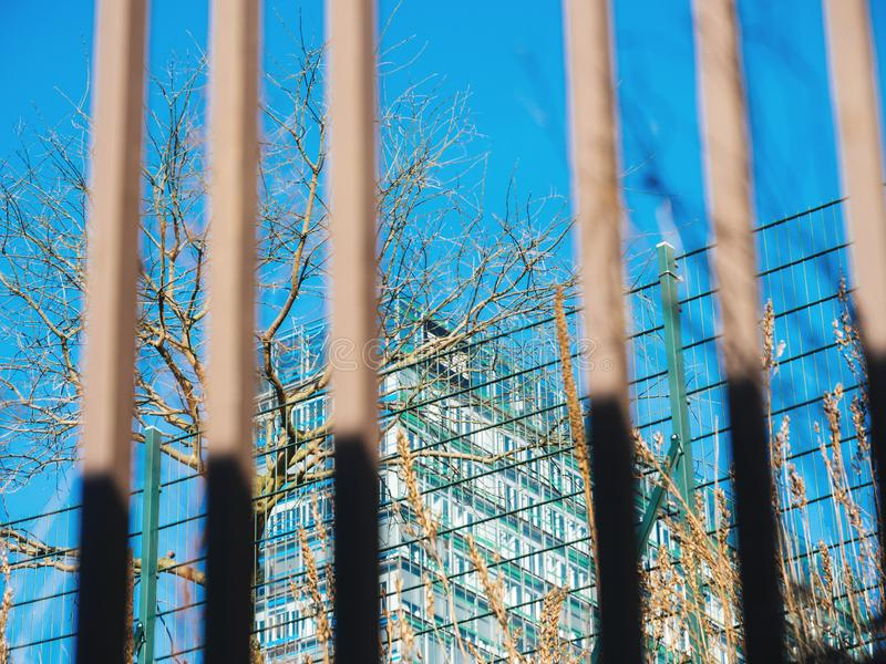 Abstract view of a business building through fence stock photos