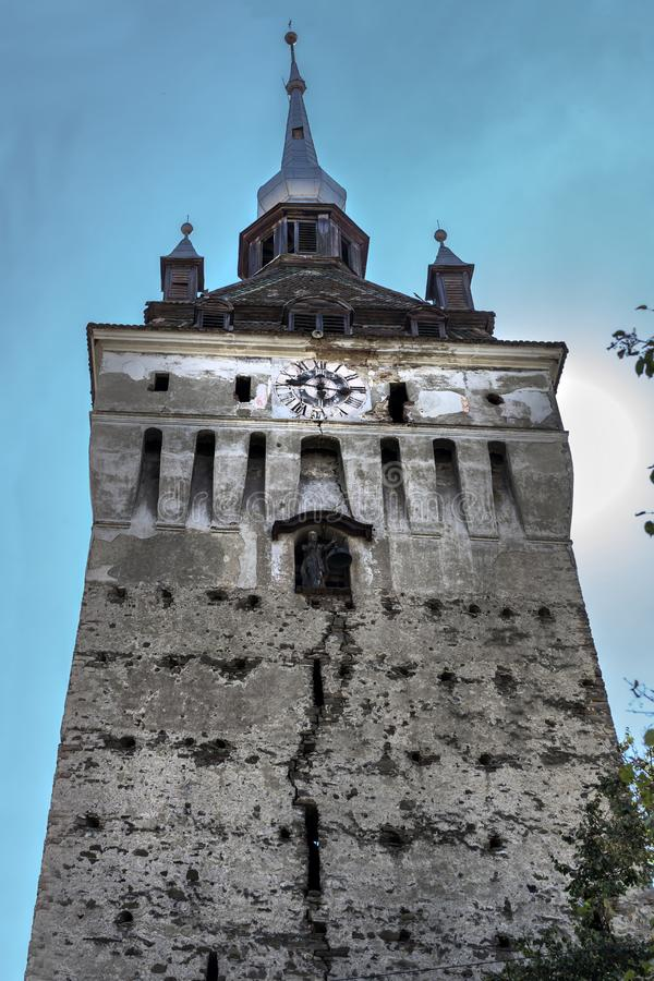 Abstract view about the cracked facade of an old medieval church tower in Szszkezd, Romania royalty free stock photography