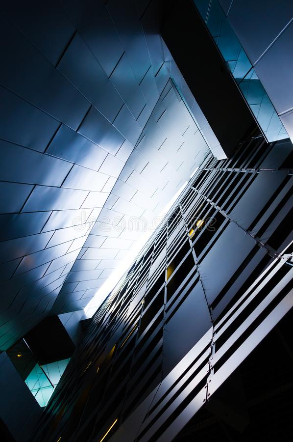 Abstract view of a modern metallic facade of a contemporary geometric building stock image