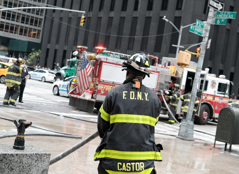 Abstract view of a Police and Fire incident in New York city, USA. Following a fire at a nearby building, both NYPD and the Fire Department can be seen in royalty free stock photo