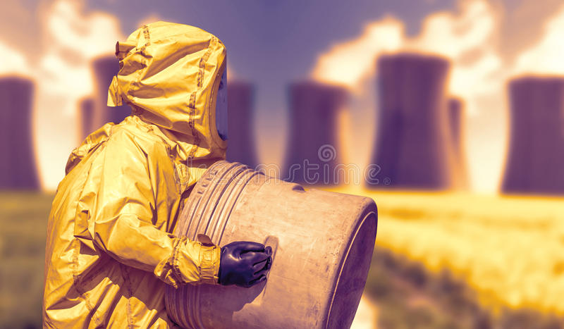 Abstract view of smoking coal power plant and men in protective hazmat suit. Industrial place royalty free stock photo