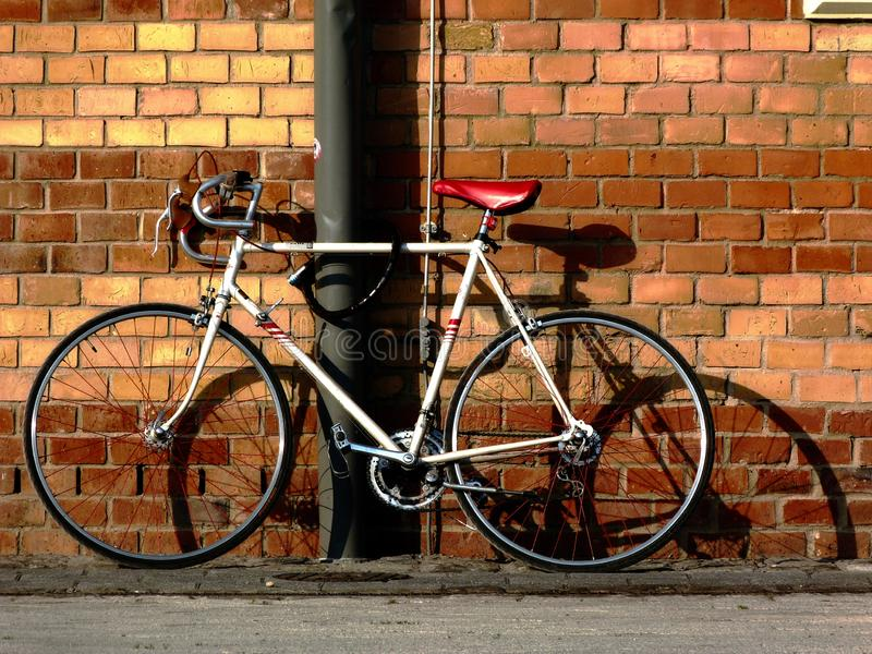 Abstract view of white racing bike with red spokes royalty free stock photos