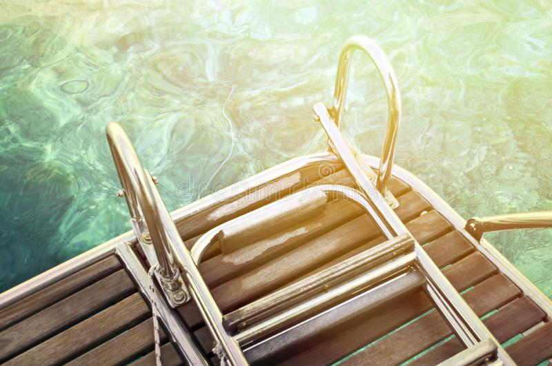 Abstract view of yacht stairs and sea water royalty free stock photos