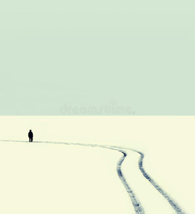 Abstract vintage photo silhouette of a man on the road stock photography
