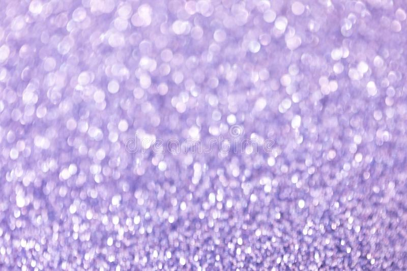 Abstract violet blurry glitter background with bokeh royalty free stock image