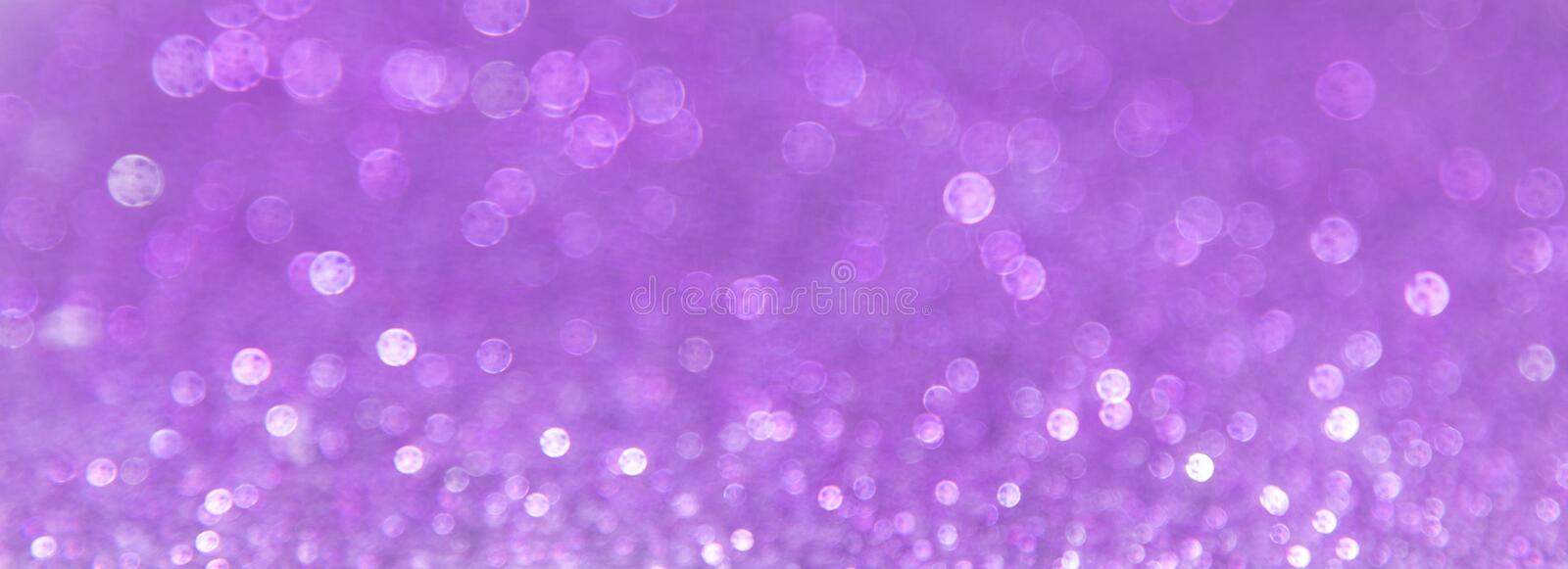 Abstract violet bokeh background royalty free stock photos