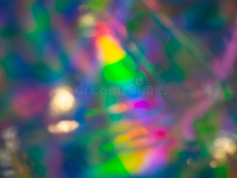 Abstract vivid wallpaper of holographic lens flare neon lights with spectrum psychedelic saturated neon colors and shiny glowing r stock photography