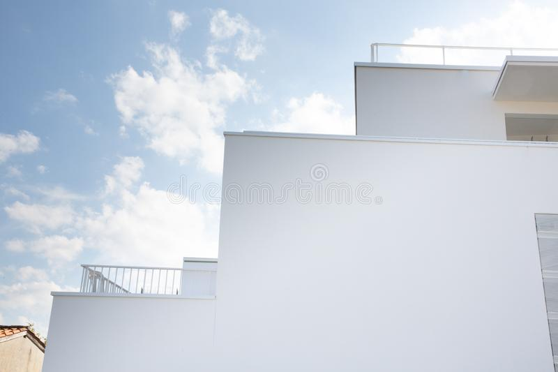 Abstract wall contemporary luxury geometric building on blue sky royalty free stock images