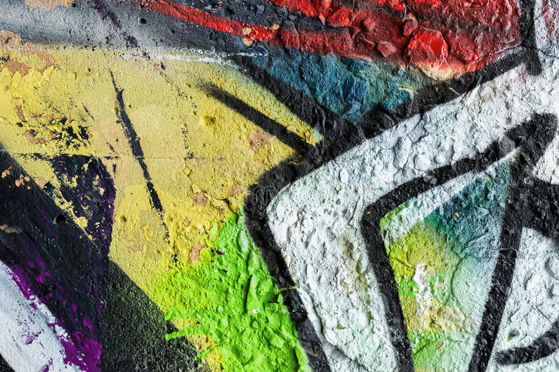 Abstract wall, decorated with drawings paint , close-up. Detail of graffiti . Fragment for background, stylish pattern stock image