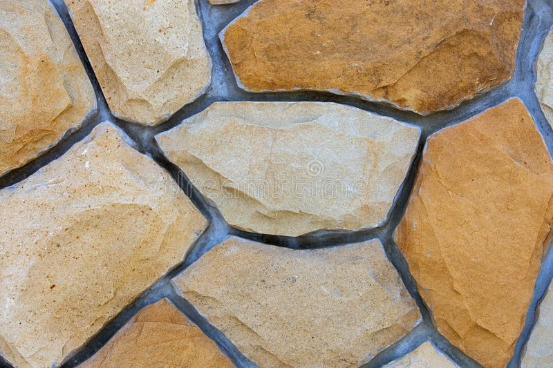 Abstract wall surface made from sand stones for usage as background royalty free stock photos