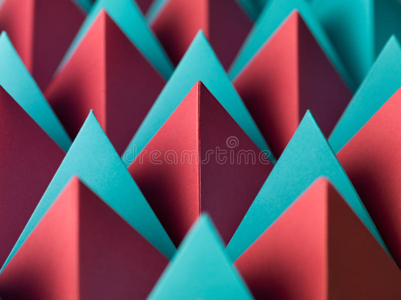 Abstract wallpaper. Abstract geometrical background with colorful paper pyramids. selective focus stock photo