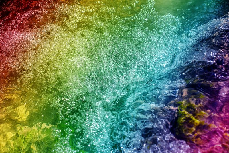 Abstract Water Drops on Colorful Background. Design of Creative Watery Texture. red, blue, green, purple, yellow. stock photo