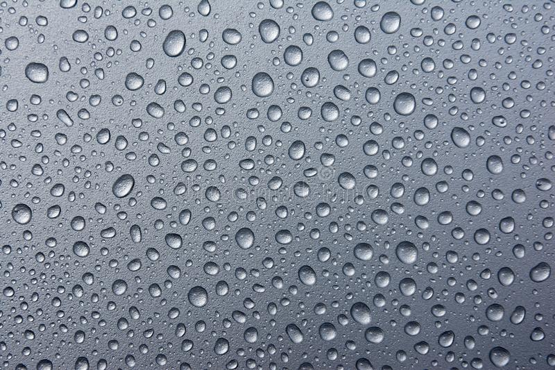 Abstract water drops on a silver background. water drops on dark metaltexture. Abstract water drops on a silver background. water drops on dark metal background royalty free stock photography