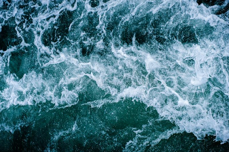 Abstract water ocean waves texture background. Surface of sea wave splash and foam royalty free stock image