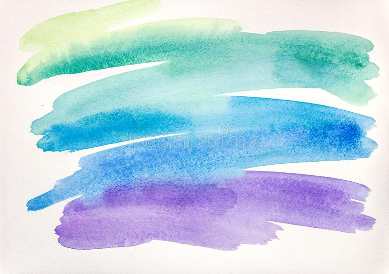 Abstract watercolor brush strokes in green and blue color on white paper stock photography