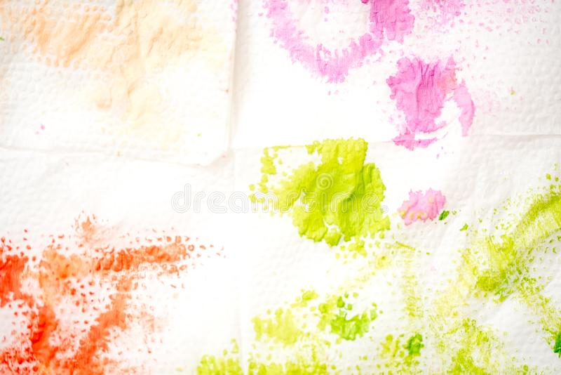 Abstract watercolor hand painted background. Green stain of paint on a white napkin. Abstract watercolor hand painted background. A green, magenta, red stain of stock photos