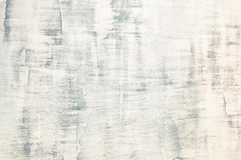 Abstract weathered texture stained old stucco light gray and aged paint white brick wall background in rural room royalty free stock photo