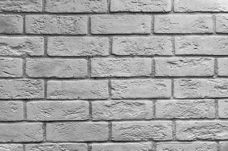 Abstract weathered texture stained old stucco light gray and aged paint white brick wall background in rural room royalty free stock photos