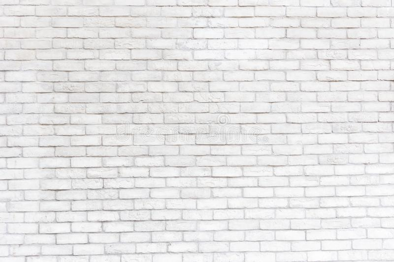 Abstract weathered texture stained old stucco light gray and aged paint white brick wall background in rural room, royalty free stock photography